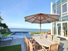 The Most Stunning Waterfront Homes in the Hamptons Sag Harbor  Enjoy breathtaking bay views from inside this contemporary home, as well as the heated pool and spa, stone patio, and roof deck. Thanks to steps leading directly from the lawn down to the bay beach, you can take a swim at any time