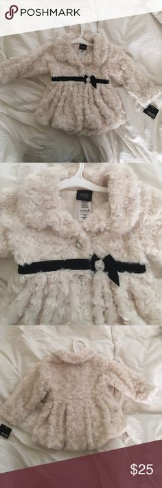 Gorgeous NWT faux fur holiday coat. Beautiful winter white/cream faux fur coat. Crystal look buttons with a black velvet ribbon. Super soft and perfect for Christmas , New Years or any Holiday or party. Jackets & Coats