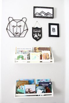 We're obsessed with this black and white woodland gallery wall!