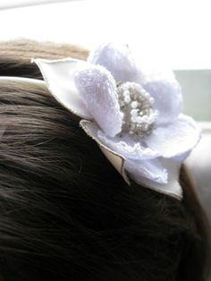 Serre-tête fleur blanche €35.00