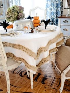 <3 this tablecloth~Embellish a thrift store or hand-me-down tablecloth with strips of burlap or linen for a chic, budget-friendly update.   #tablescape #thanksgiving