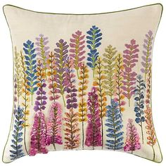 Our hand-made Lupine pillow is brought to life by hand-printing, embroidery and stitched ribbons on a 100% cotton background.