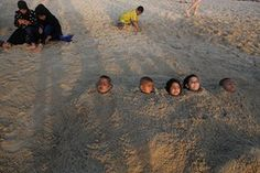 Tel Aviv, Israel: Muslim Israeli-Arab children play on the beach during the three-day Eid al-Adha holiday