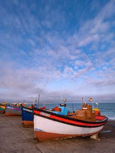 Colorful Fishing Boats 3 is a photograph by Dan Leffel. South Africa Arniston Seaport Fishing Boats. Source fineartamerica.com