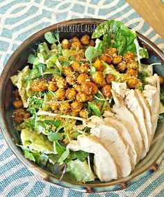 Makes 4-5 servings  What you need: 1-2 pasture-raised chicken breasts, cooked and sliced  3 heads romaine 1 small clam microgreens  CHICKPEA CROUTONS: 1 small can organic chickpeas (1 ½ cups cooked) 1 tbsp coconut oil, melted Himalayan Salt Black Pepper  DRESSING: 1/4 cup raw cashews, soaked overnight 1/4 cup hemp hearts ¼ cup filtered water 2 tbsp extra virgin olive oil 2 tbsp fresh lemon juice ½ tbsp dijon mustard 2-4 garlic cloves ½ tbsp coconut aminos Himalayan Salt Black Pepper  Raw…