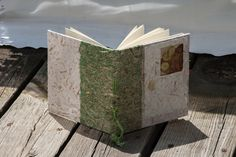 A personal favorite from my Etsy shop https://www.etsy.com/listing/198531493/long-stitch-book-with-seedpods-corn