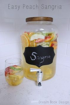 An easy peach sangria recipe-perfect for Spring time. You can switch it out to put any fruit you like in it. So light and refreshing. on dreambookdesign.com