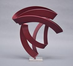 """Pinot"" by Bret Price. Red abstract steel sculpture."