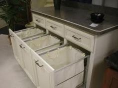 Built in laundry sorting in under cabniets!!!!  Could my house ever get to the point that this is my laundry room?