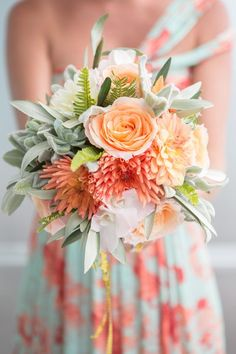 I really like this coral, peach and succulent bouquet color combination with the bridesmaid's dress. Lovely!