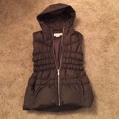 Michael Kors vest Beautiful chocolate brown Michael Kors hooded sleeveless puffer vest. Has pockets in front. It runs a little big so could also fit a small. Brand new condition. Michael Kors Jackets & Coats Vests