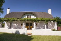 Manley Wine Lodge - Manley Wine Lodge is situated in a tranquil country setting in Tulbagh, South Africa. Manley Wine Lodge is a little piece of heaven. Surrounded by majestic mountains, sweeping vineyards and orchards, this . Dutch Kitchen, House Plans South Africa, Facade House, House Facades, Cape Dutch, Dutch House, Self Catering Cottages, Cape Town, Weekend Getaways