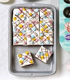 Rich chocolate brownies sprikled with pastel candy-covered chocolates. | Free Chocolate Brownie Easter Recipe