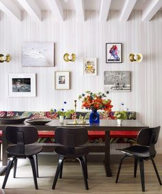 Custom banquette dining room with striped wallpaper and gallery wall with sconces on Thou Swell @thouswellblog