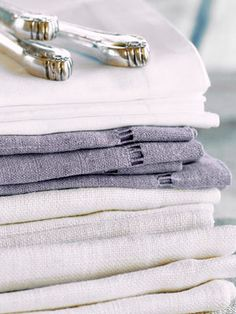 Treat soiled table linens as soon as you can. Bock recommends blotting with a little dish detergent and water right away, and if the item is a washable linen, try to launder it that day. White Napkins, Linen Napkins, Fee Du Logis, How To Fold Towels, Oil Stains, White Carpet, Pet Odors, Linens And Lace, Bed Styling