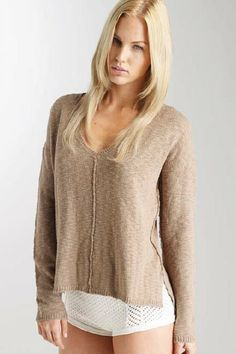 Paulina High/Low V-Neck - This high/low V-neck pullover has a boxy body with long, skinny sleeves and men's striped shirting detail at neck, hem and side slit.