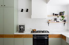 Pale green painted cabinetry in a Sydney kitchen designed by Arent & Pyke fromKitchen of the Week: A Before/After Remodel in Sydney, Australia.