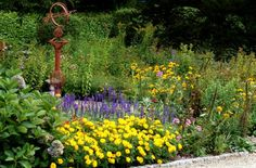 10 Ways to Make Your Yard Look Like Hell: Ornament Overkill in Flower Beds: One Nice Piece Goes a Long Way