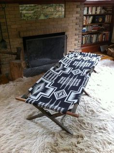 Cool combo — Pendleton blanket with a camping cot.