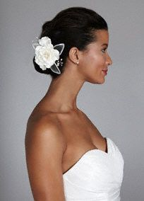 What a beautiful way to play up your wedding hair style! This charming flower is the perfect accessory for your big day.  Flower headpiece features horsehair andvery unique sequin detailed petals, along with stunning crystal and pearl sprays.  Available in Ivory and White.  Imported.
