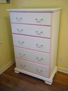 some sandpaper, Kilz and paint, and an old Sauder dresser is reborn as my daughter's pink & white dresser! I used brushed nickel spray paint for the hardware