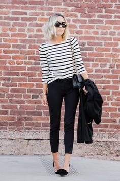 Polished look with black stripes and black pants.