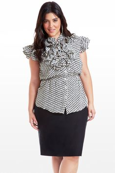 This adorable short sleeved blouse features a playful animal-dot print, feminine details, and flattering cut. Features include a button front, cinched elastic waist, curved ruffle hem, and ruffle neckline. Looks perfect with black and white or silver accessories, finished off with black pants and heels.