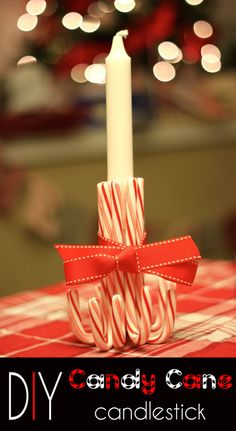 #DIY candy cane candlestick holder- perfect for the holiday dinner table!