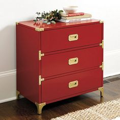 Campaign style furniture was developed in the 19th century to break down and move with British officers across the empire. Our Charlotte 3-Drawer Campaign chest captures the well-traveled look in crisp, handcrafted details, including riveted metal corner brackets, flush bail handles and bracket feet, all finished in antique brass. Charlotte 3-Drawer Campaign Chest features: Dovetailed wood stained drawersCrafted of mahogany & fine veneers