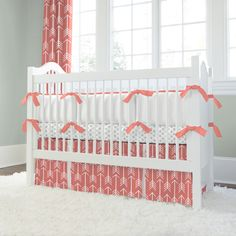 Coral Crib Bedding with Arrows - two trends we love: coral and arrows paired in this modern crib bedding set! #PNshop