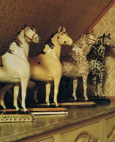 Earthenware horses manufactured in Leeds, England in the 18th century. Made for saddle shop's windows, they are 19 inches tall.