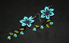 Dimensions: Width: 1 Hang 3  ***Every order and customer is treated with the highest regard. Please see our review section here: https://www.etsy.com/your/shops/BiuluArtisanBoutique/reviews?ref=shop_info ***Gift packaging available! See below for more information***   Item info:  - These beautiful hand-beaded Huichol Earrings are bright and fun.  - They are made using a thread and needle technique.  - The flowers are not flat and have a defined inside and ou...