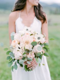 Anemone, chrysanthemum, peony, and eucalyptus wedding bouquet: Photography : Connie Whitlock Read More on SMP: http://www.stylemepretty.com/colorado-weddings/tabernash/2016/10/10/rustic-glamour-pastel-outdoor-ranch-wedding/
