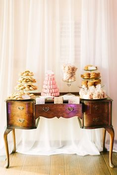 pink and gold dessert on a beautiful sideboard table.