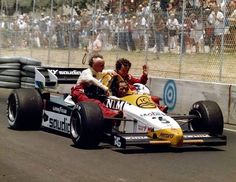 This is the mother of all taxi cab pictures. It was taken at the 1984 USA GP and it's Jacques Laffite giving Prost and Lauda a lift.