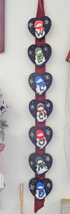 winter welcome snowmen on black wooden hearts wreath