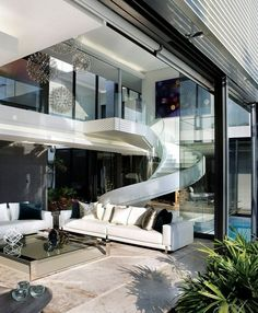 Modern Great Room with French doors, complex marble tile floors, High ceiling, Paint, Spiral staircase, Indoor/outdoor living