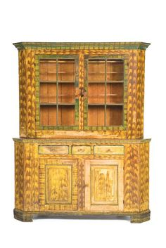 """DECORATED CORNER CUPBOARD.  Pennsylvania, mid 19th century, mixed woods including walnut.  80""""H. 62""""W."""