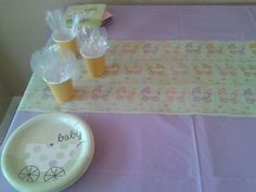 Used plastic table cloths from the dollar tree, then used dollar tree wrapping paper (cut in half) bas a table runner!