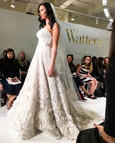 How amazing are the flower appliqués on this @watterswtoo gown? #NYBFW #bridalmarket #bridalweek #bridalfashion #bridalfashionweek #weddingdress #bridalinspiration #watters