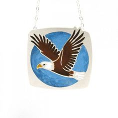 Shape of American Eagle is laser cut into sterling silver and filled with colorful resin.