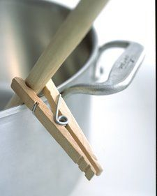 Use a clothespin to keep utensils from sliding down into the pot