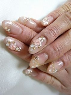 3D nail art for the bride.