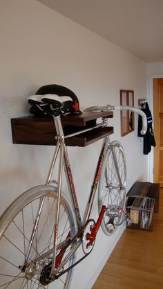 very functional for those of us who have very little storage space :)  Bike Shelf  Distressed Walnut by IndependentWoodworks on Etsy, $250.00