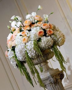 Beautiful urn arrangement - hydrangeas and dripping type greenery on bottom, roses in the center, and carnations on top