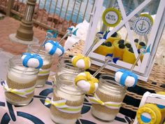 I love this Nautical themed baby shower and the idea of powdered donuts as lifesavers on the milk glasses