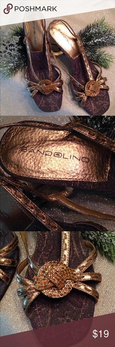 """Bandolino BDQuentin bronze leather sandals Bandolino BDQuentin bronze leather dressy sandals with ambers rhinestone rosette trim. Size 6. 3"""" heels. Mint condition. Worn once. A lovely accessory for your holiday parties. Bandolino Shoes Heels"""