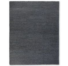 RH's Hand-Braided Jute Rug - Navy:Braided by hand from thick strands of natural jute, these rugs have a chunky, textural appeal and a soft feel underfoot. Our rugs are artisan crafted and no two are alike. Given their handwoven nature, slight variations in shading and size are inherent to the design. Imported. 100% jute braids; 100% cotton base.Additional view shown in silver.Deluxe Rug PadLow Profile Rug Pad