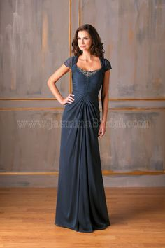 Jasmine Bridal Mother of the Bride/Groom Dress Jade Style J175010 in Navy Blue. Feel glamorous and look ravishing in this beautiful special occasion gown. Dress features a queen neckline and A-line skirt. The dress is touched up with beautiful ruching detail and elaborate beading on the bodice.
