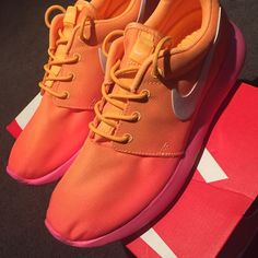 Brand New Pink & Orange Nikes brand new NEVER worn! still in box! boyfriend bought me wrong size im a size 6. wish i could keep these but their too big :( Nike Shoes